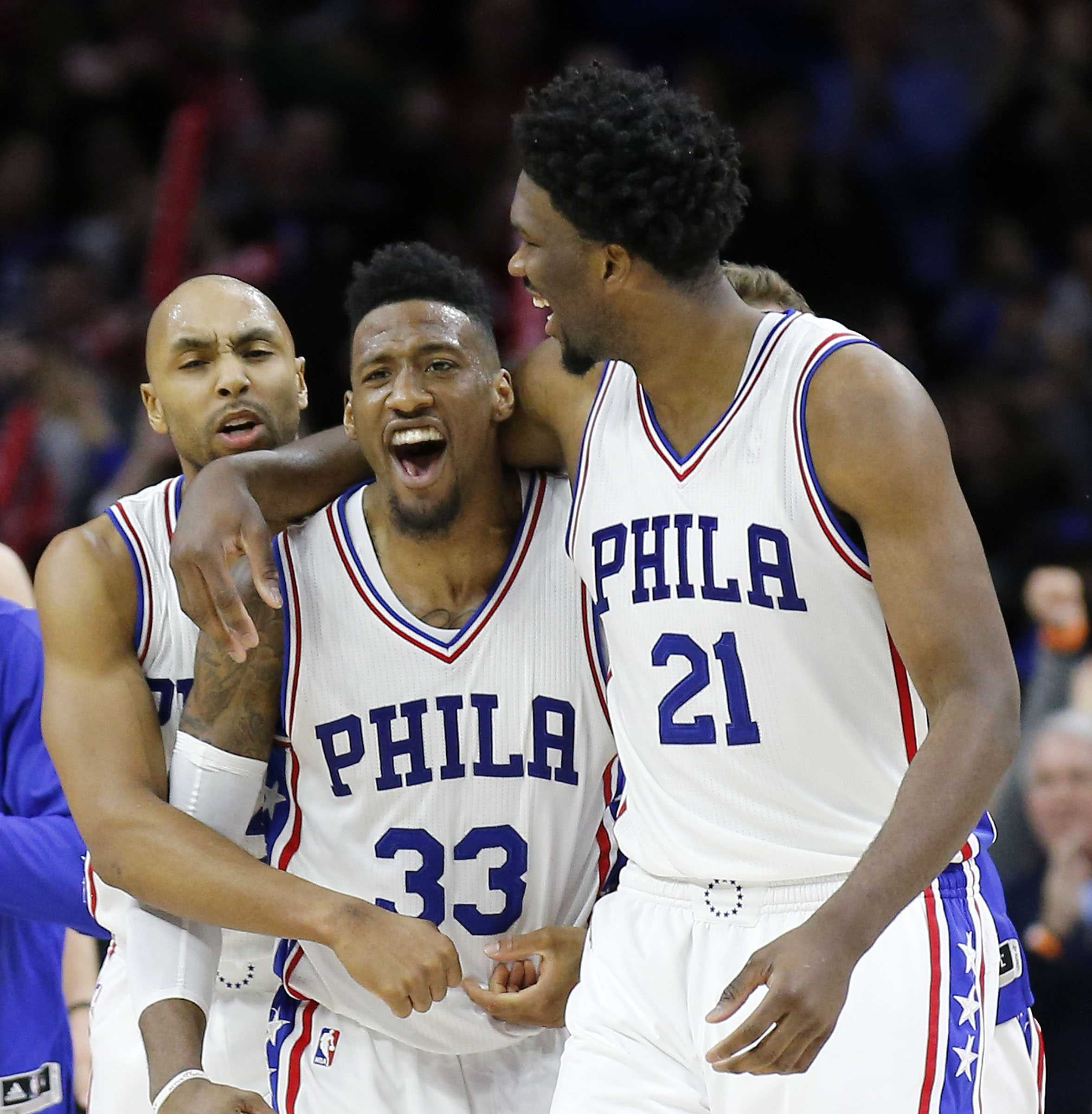 The Philadelphia 76ers' Robert Covington (33) celebrates with teammates Joel Embiid (21) and Gerald Henderson after a 93-92 win against the Portland Trail Blazers on Friday, Jan. 20, 2017, at the Wells Fargo Center in Philadelphia. (Yong Kim/Philadelphia Daily News/TNS)
