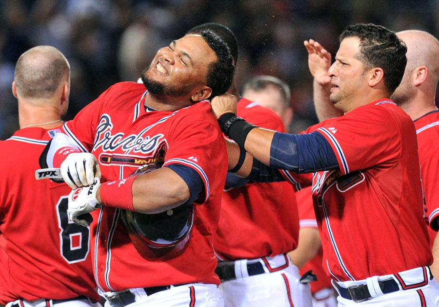 The Atlanta Braves' Juan Francisco, second from left, is surrounded by teammates to celebrate his game-winning RBI single against the Los Angeles Dodgers in the 11th inning at Turner Field in Atlanta, Georgia, on Friday, August 17, 2012. (Hyosub Shin/Atlanta Journal-Constitution/MCT)
