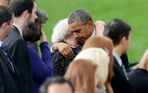 President Barack Obama comforts families of the victims at a memorial for the victims of the Washington Navy Yard shooting at the Marine Barracks in Washington, D.C., on Sunday, September 22, 2013. (Olivier Douliery/Abaca Press/MCT)