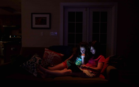 Sheri Jacobs and her daughter, Jillian, 10, use an iPad as they relax on the couch at their home in Deerfield, Illinois, on June 29, 2012. Some doctors worry about light from electronic devices having a detrimental effect on sleep. (Chris Sweda/Chicago Tribune/MCT)