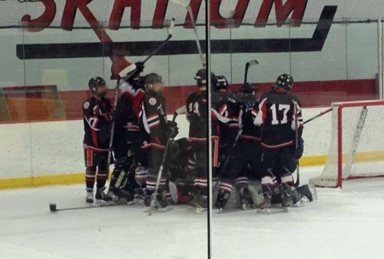 Harriton's boys' ice hockey team celebrates after first ever win against LM.
