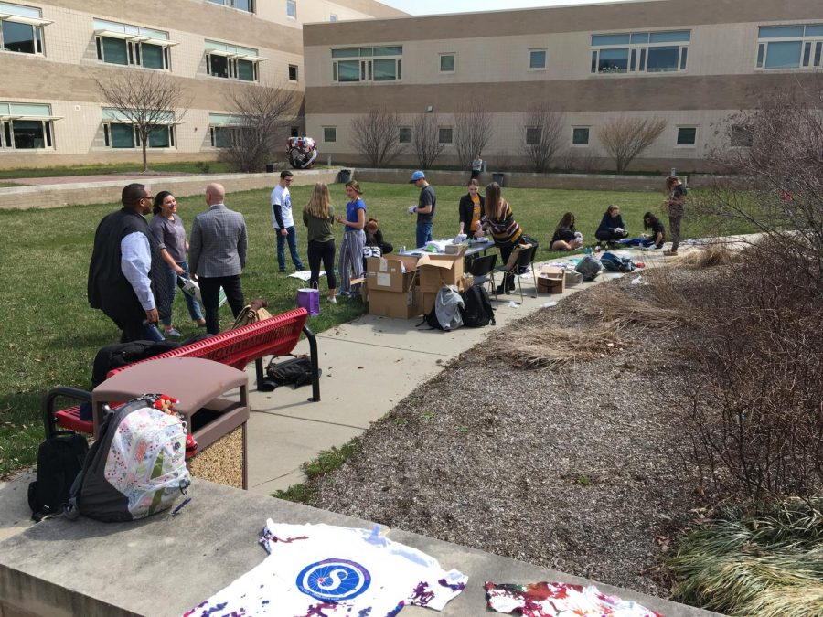 Harriton students tie-dye Adam Spector Walk T-shirts in the courtyard, April 12, 2018.