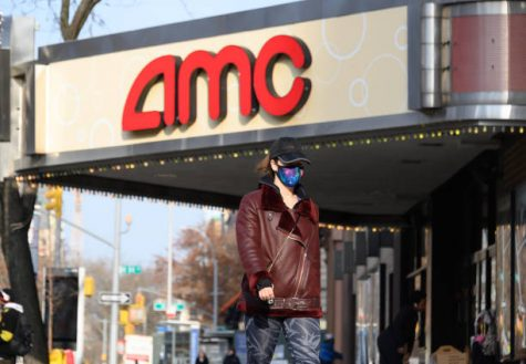 NEW YORK, NEW YORK - DECEMBER 11: A person wears a face mask outside AMC 84th Street 6 movie theater on the Upper West Side as the city continues the re-opening efforts following restrictions imposed to slow the spread of coronavirus on December 11, 2020 in New York City. The pandemic has caused long-term repercussions throughout the tourism and entertainment industries, including temporary and permanent closures of historic and iconic venues, costing the city and businesses billions in revenue. (Photo by Noam Galai/Getty Images)
