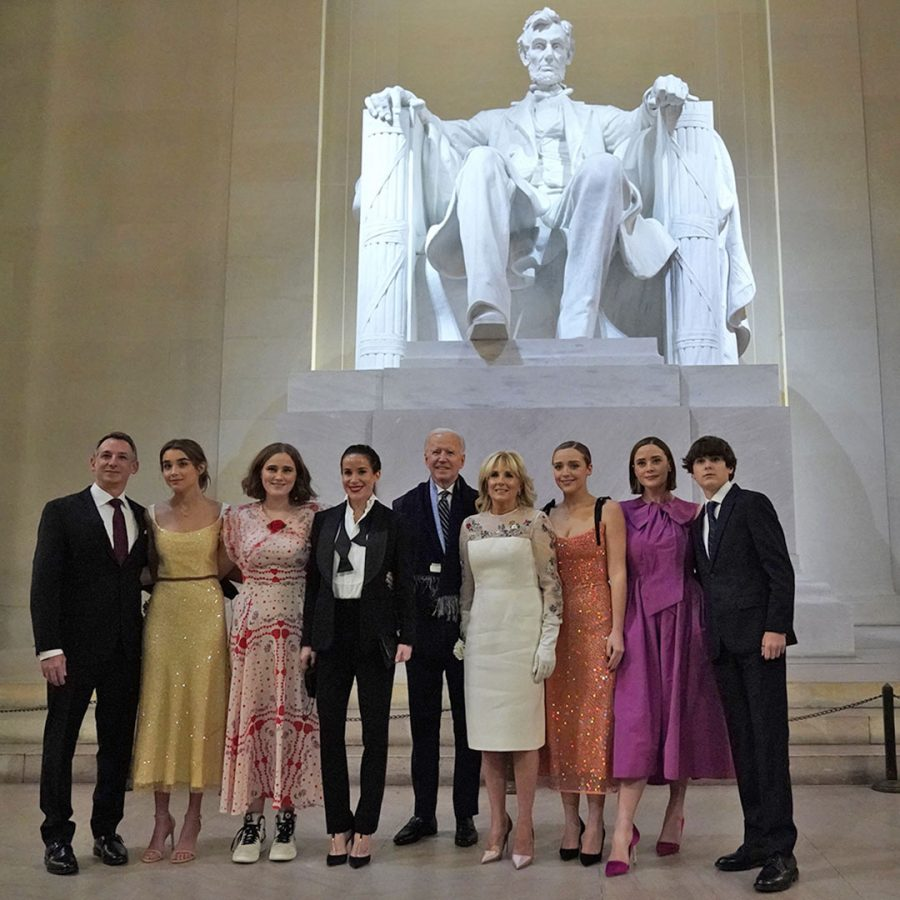 US President Joe Biden and US First Lady Jill Biden pose with their family in front of the statue of Abraham Lincoln at the