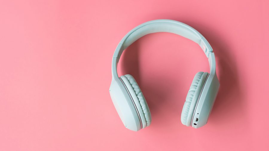 Wireless headphones on pink  background